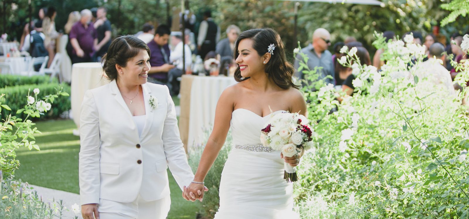 A bride and her mother holding hands