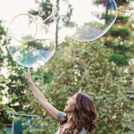 Woman creating bubbles outdoors at The Garland Hotel in Las Angeles CA