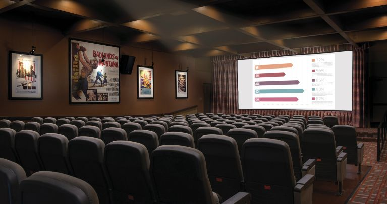 Meeting hall at The Garland with a presentation projected onto a screen.